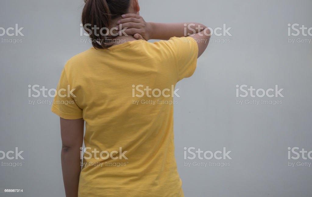 pain. girl holds neck in her hands. stock photo