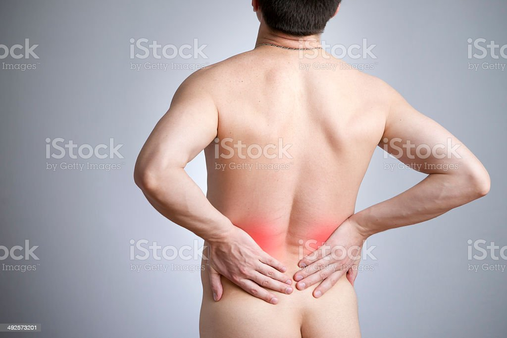 Pain in a back of the man stock photo