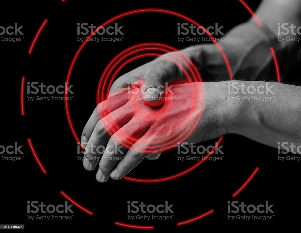 Pain in a hand, pain area of red color stock photo
