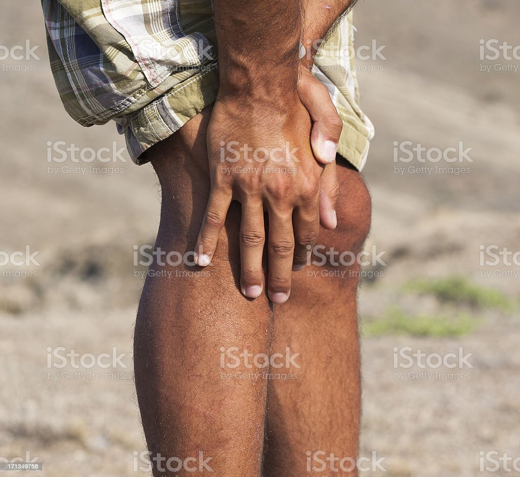Pain in a knee. marching trauma stock photo