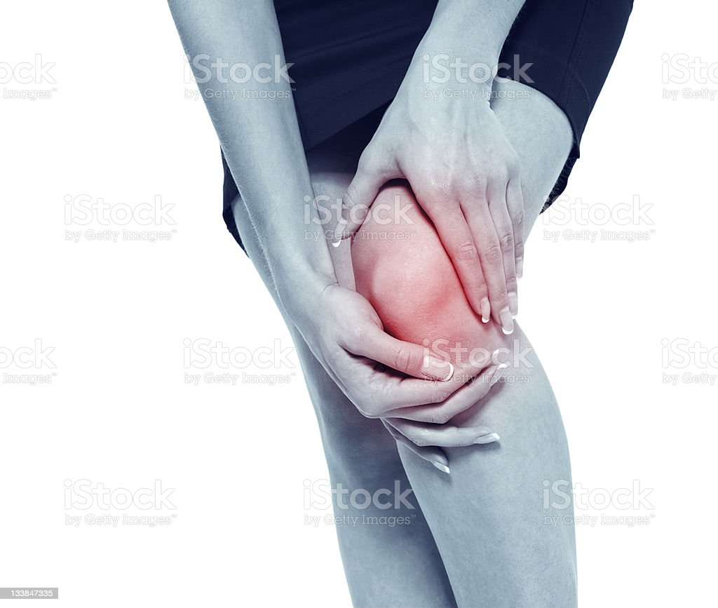 Pain in a knee royalty-free stock photo