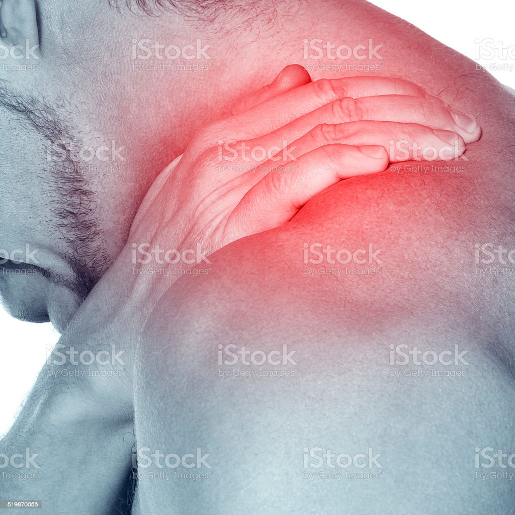 Acute pain in a neck at the young sportsman. Young sportsman masses a...