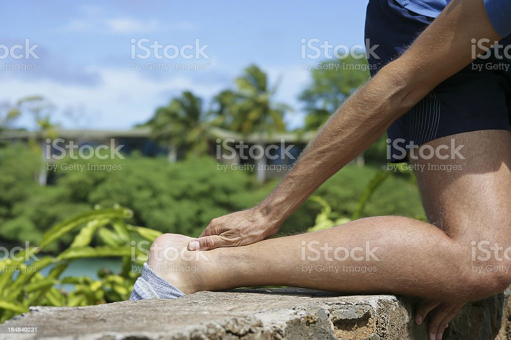 Pain in Achilles tendon stock photo