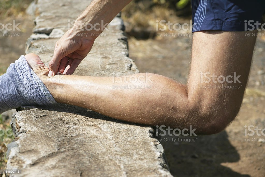 Pain in achilles tendon royalty-free stock photo