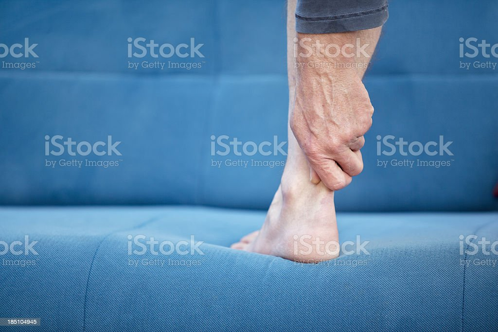 Pain in Achilles-tendon royalty-free stock photo