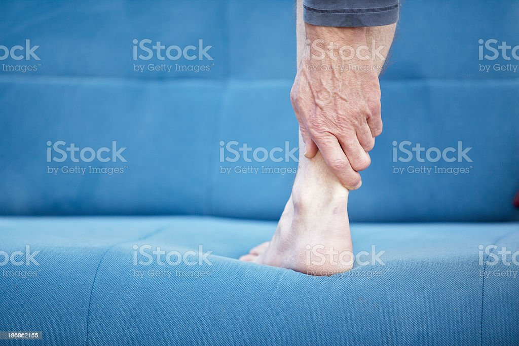 Pain in achilles-tendon stock photo