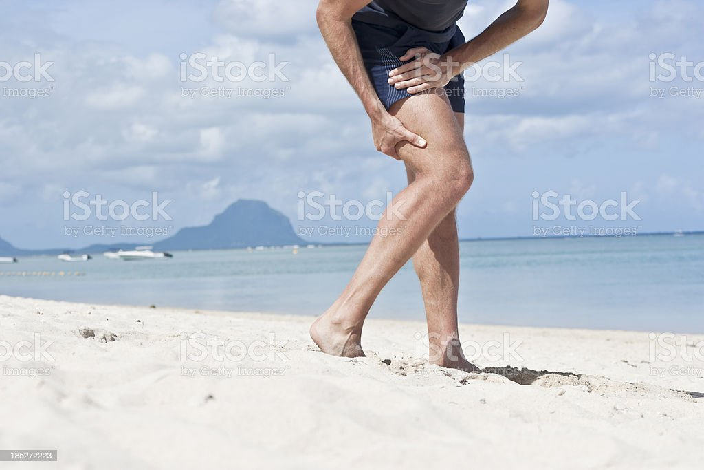Pain in hamstring muscles stock photo