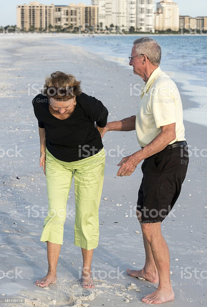 Pain in her back royalty-free stock photo