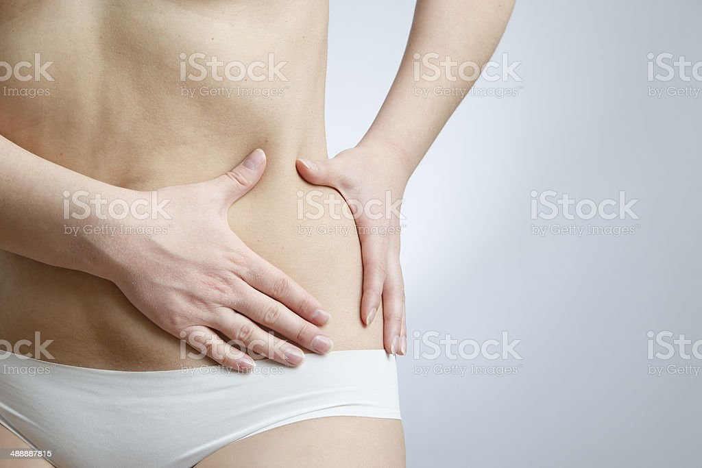Pain in left side of body stock photo