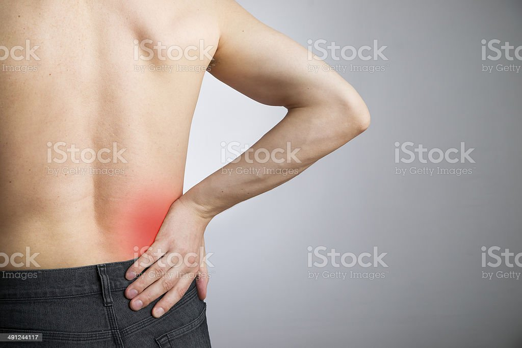 Pain in the lower back in men stock photo