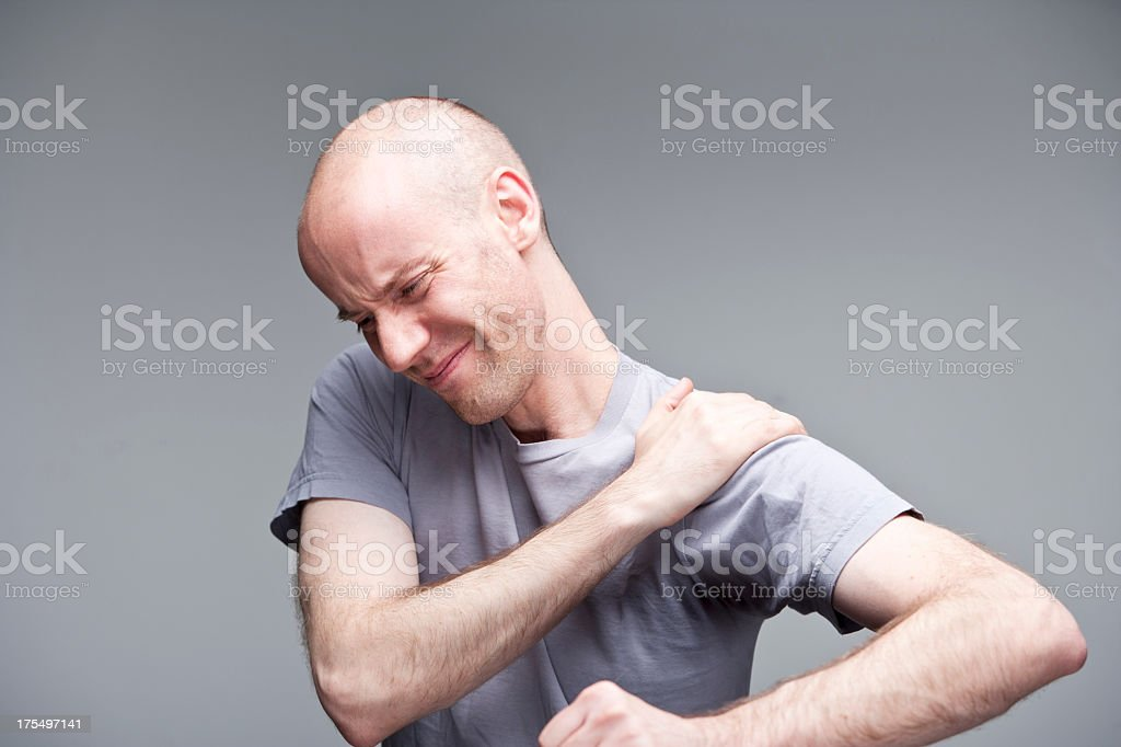 Pain in shoulder royalty-free stock photo