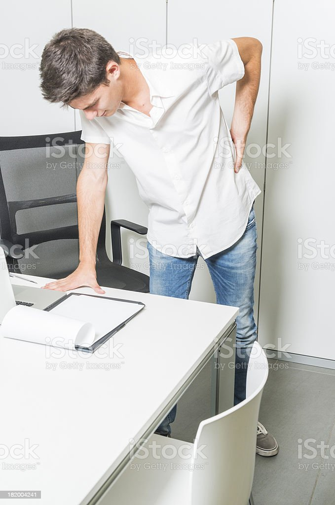 Pain in the back stock photo