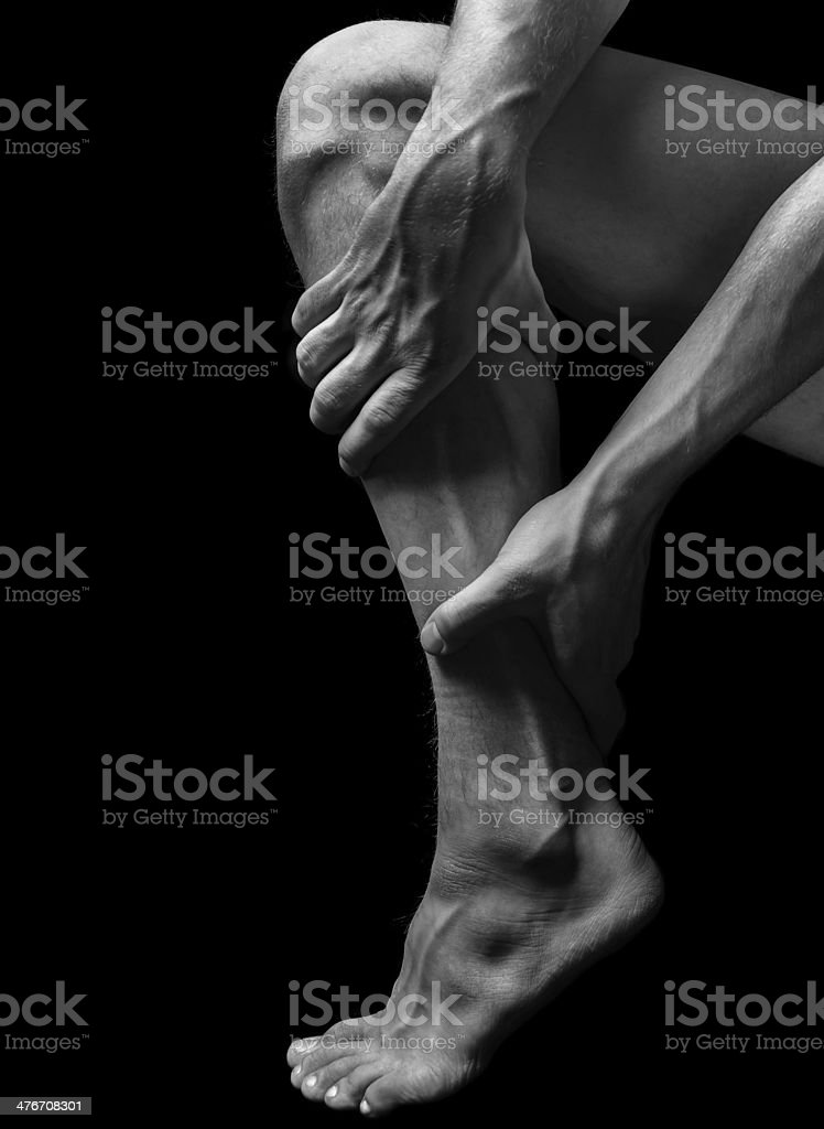 Pain in the calf muscle stock photo