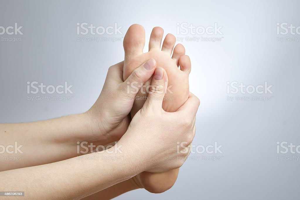 Pain in the foot stock photo
