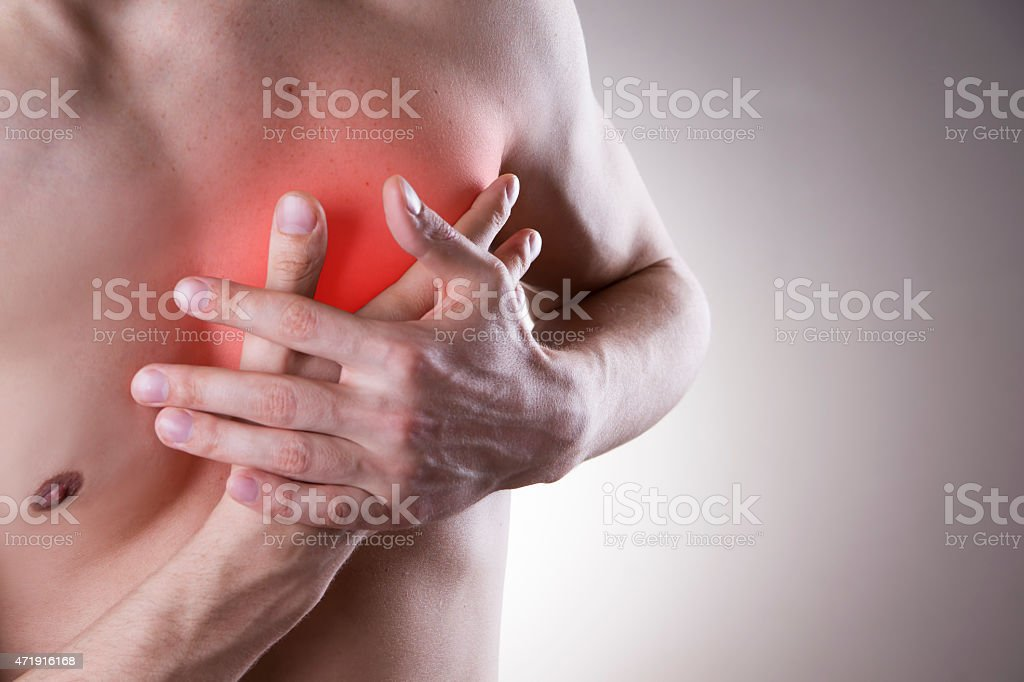 Pain in the heart of a man stock photo