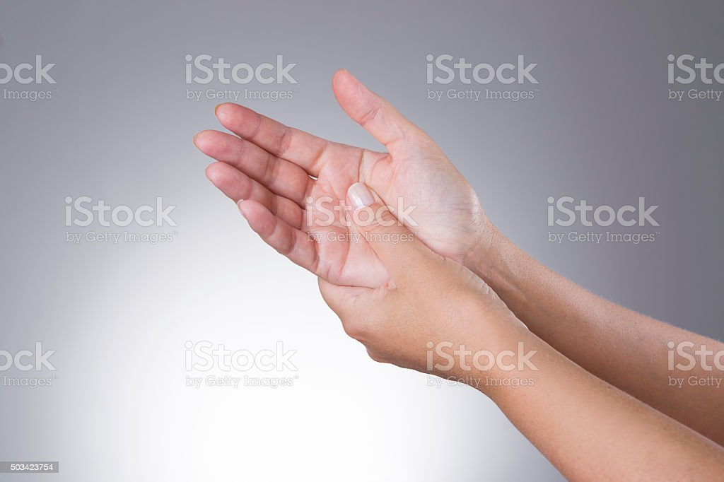 Pain in the joints of the hands. Carpal tunnel syndrome stock photo