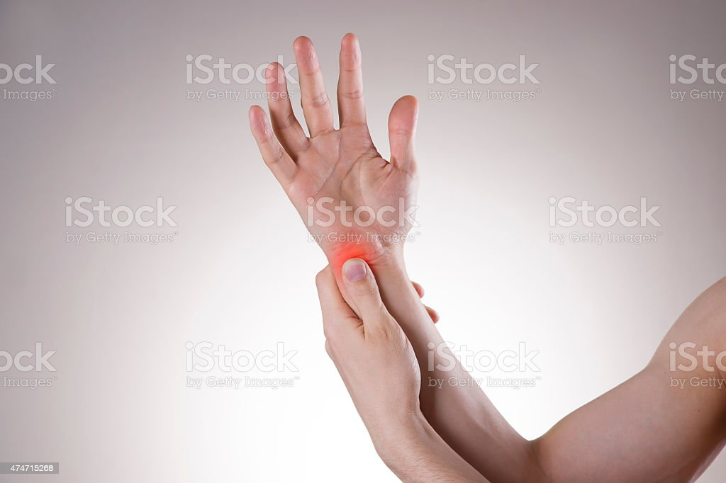Pain in the joints of the hands stock photo