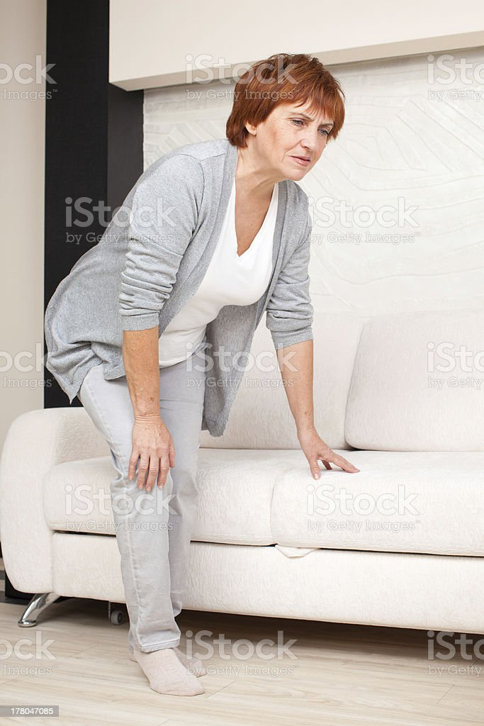 Pain in the knee stock photo