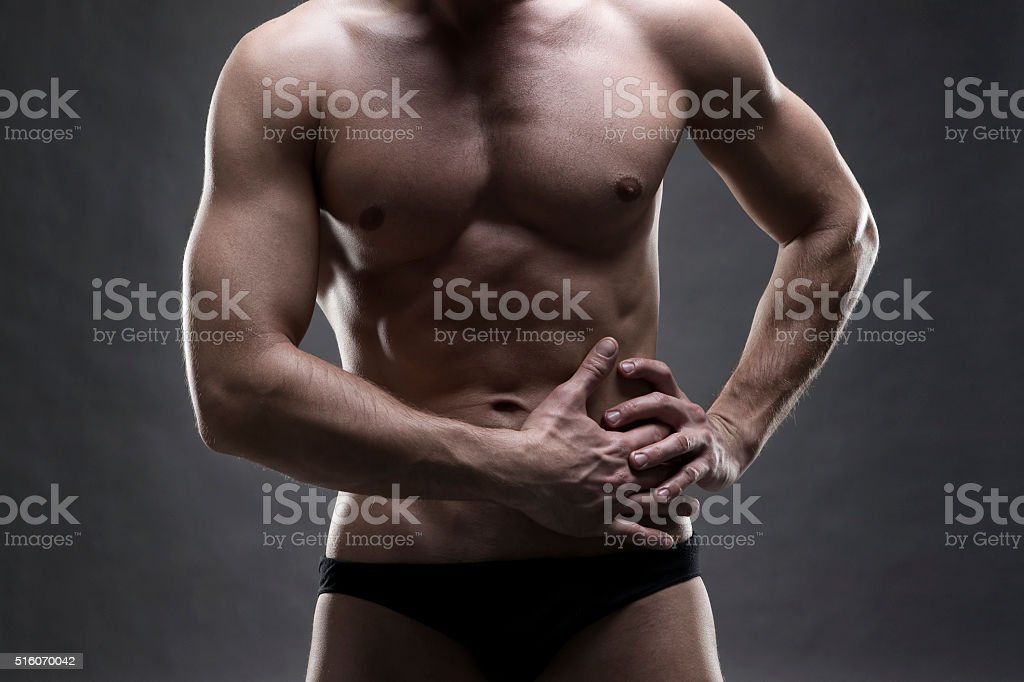 Pain in the left side of the muscular male body stock photo