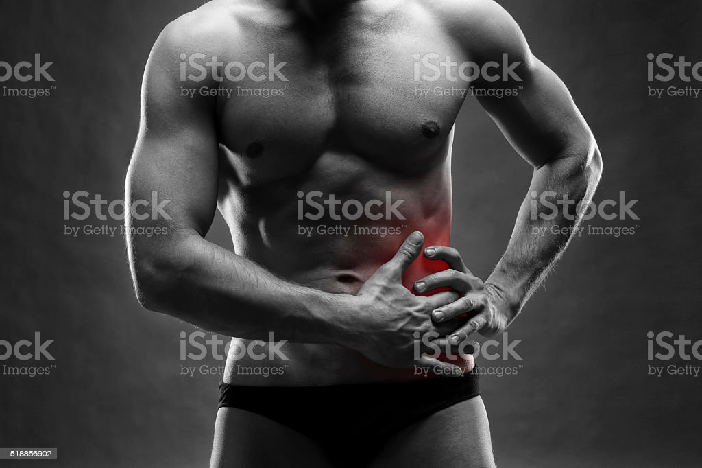 Pain in the left side on gray background stock photo