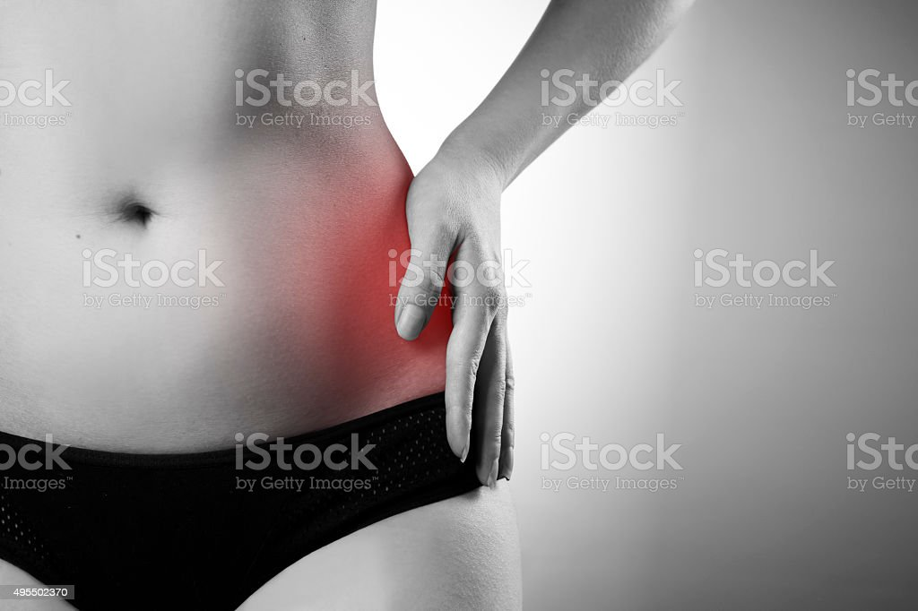 Pain in the left side stock photo