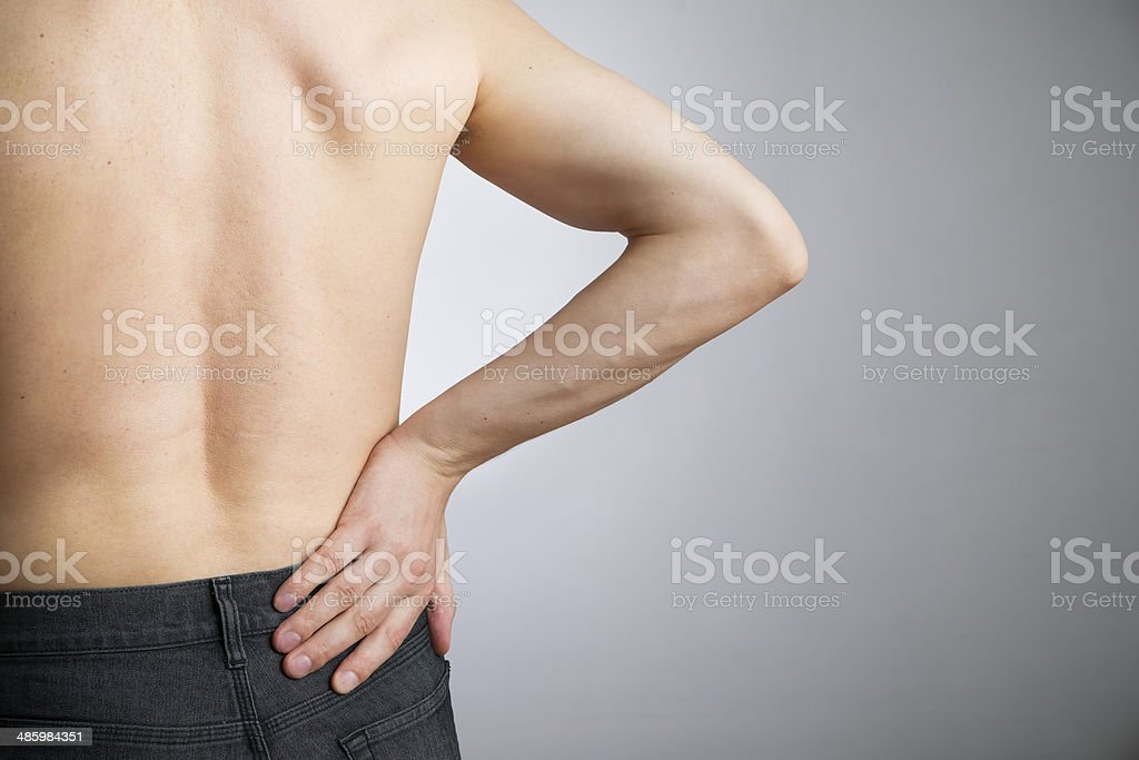 Pain in the lower back stock photo