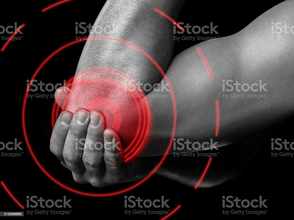 Pain in the male elbow, painful area of red color stock photo