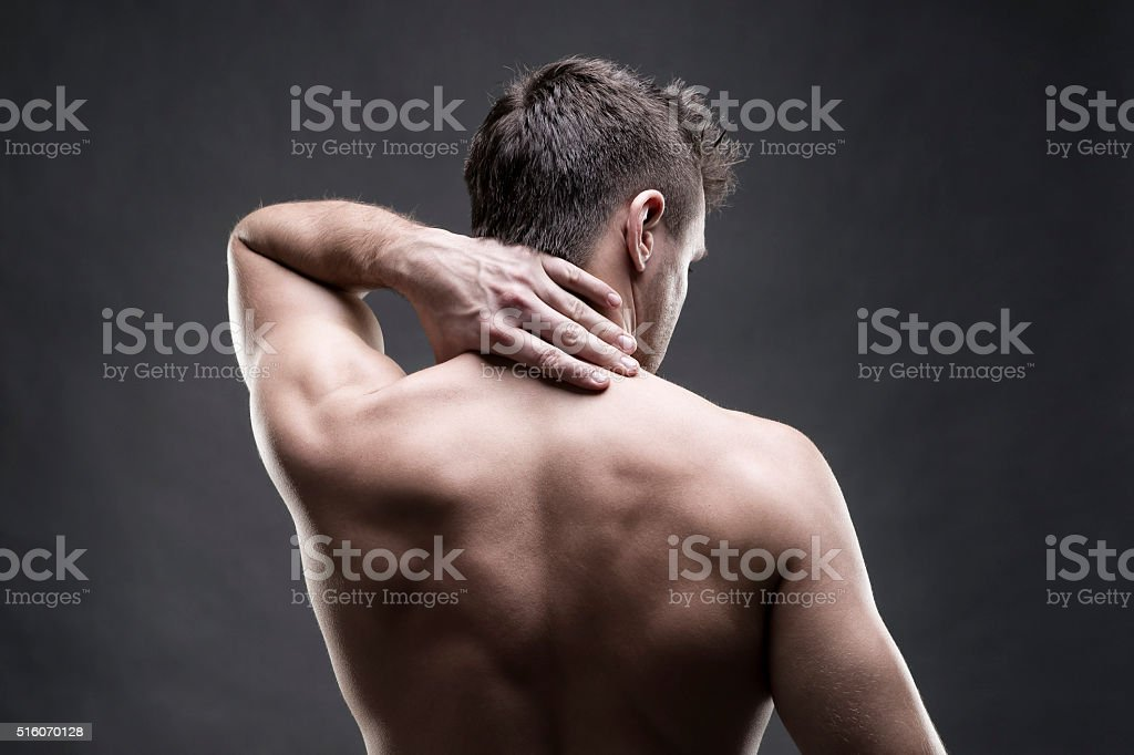 Pain in the neck on gray background stock photo