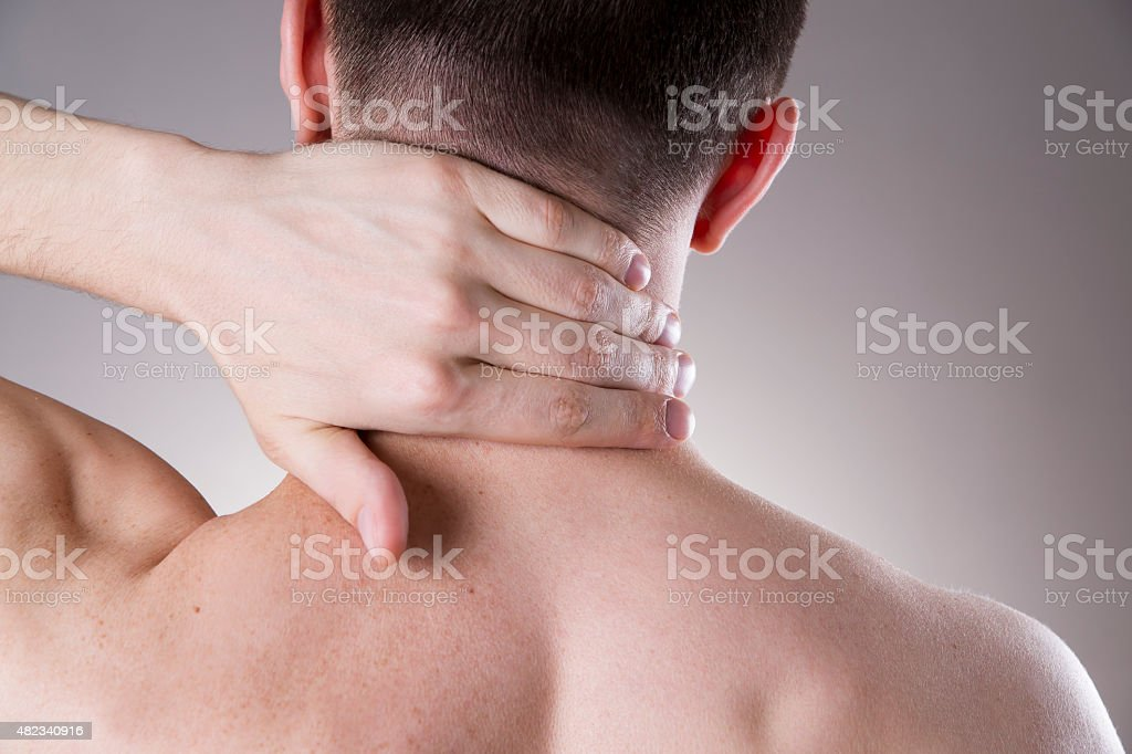 Pain in the neck. Man with backache. Pain in the man\'s body on a gray...