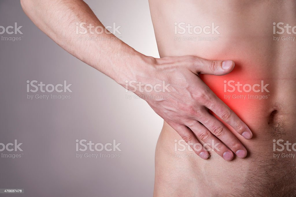 Pain in the right side of the man stock photo