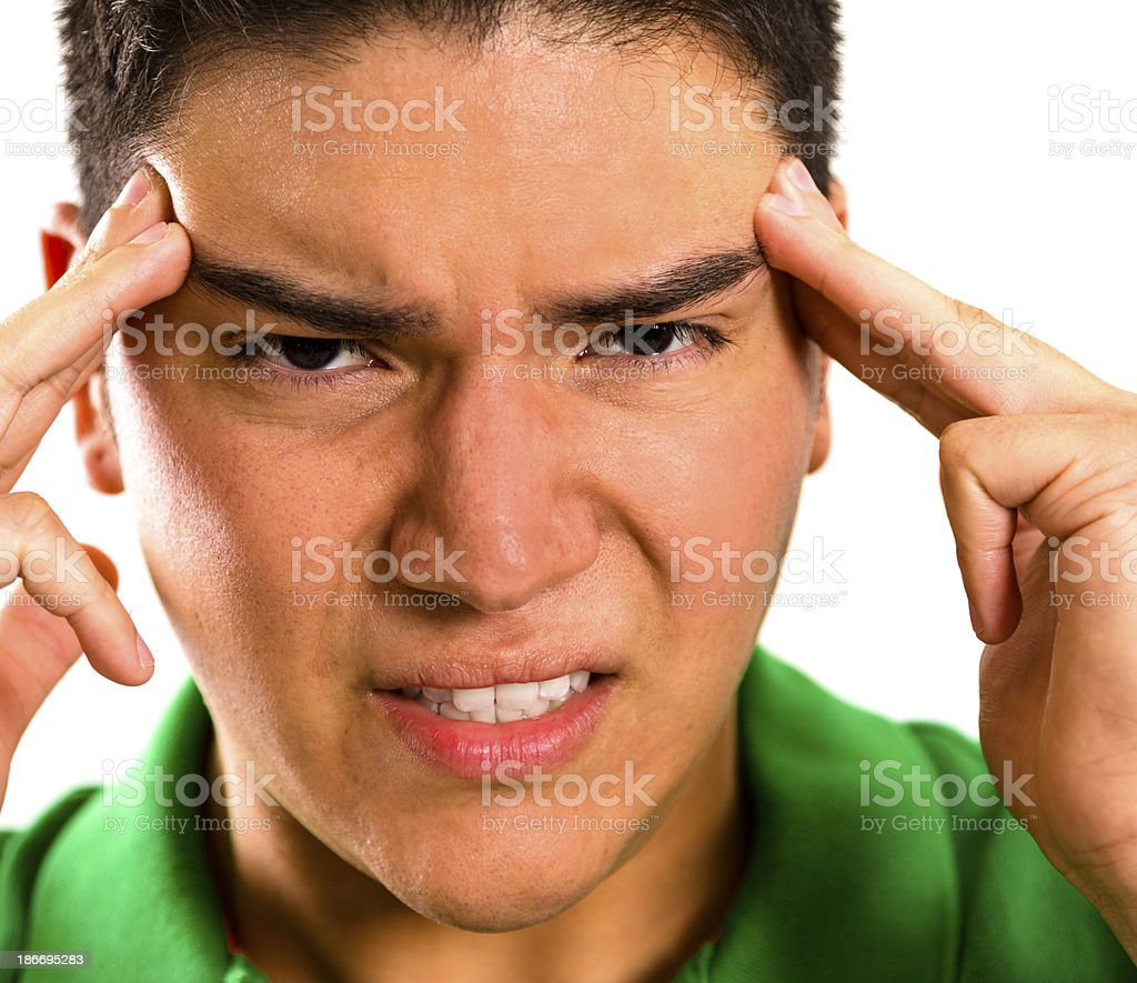 Pain:  Man massaging his temples. Headache. royalty-free stock photo