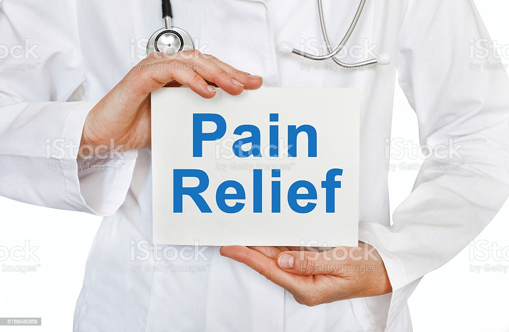 Pain Relief card in hands of Medical Doctor stock photo