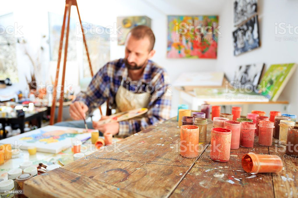 Painer drawing in his studio stock photo