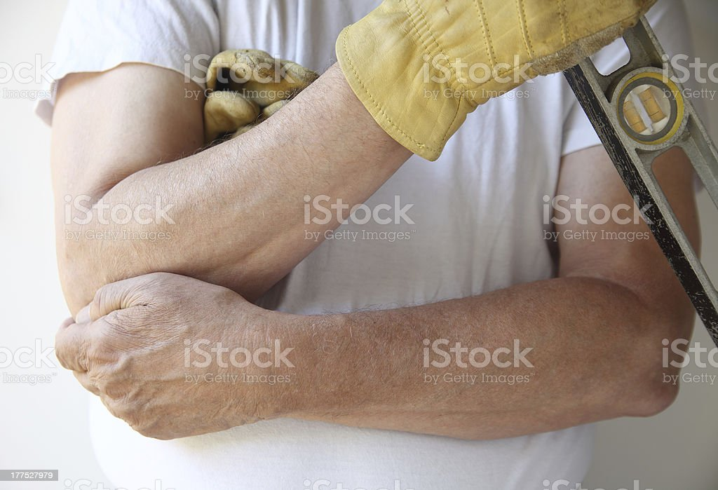 painful elbow on workman stock photo