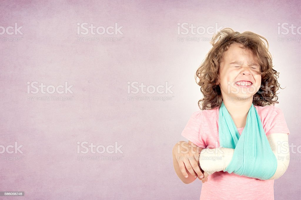 Painful facial expression on kid stock photo