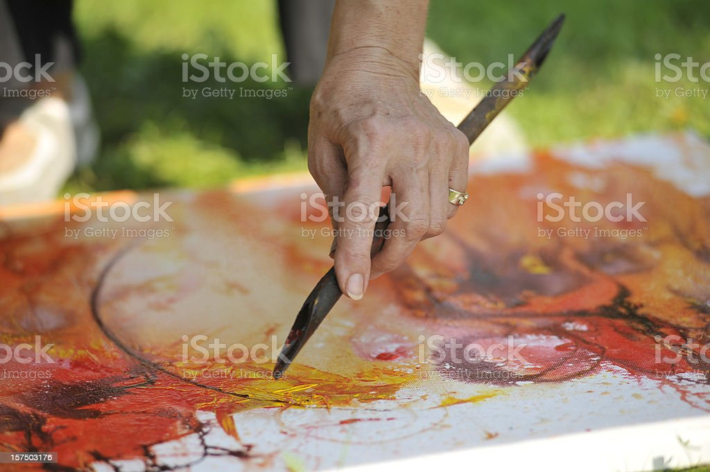 Paint - Arm painter, Drawing lines stock photo