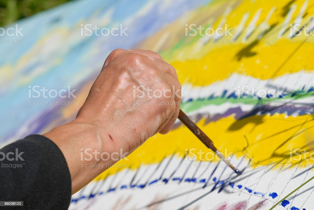 Paint - Arm painter, who holds brush in his hand stock photo