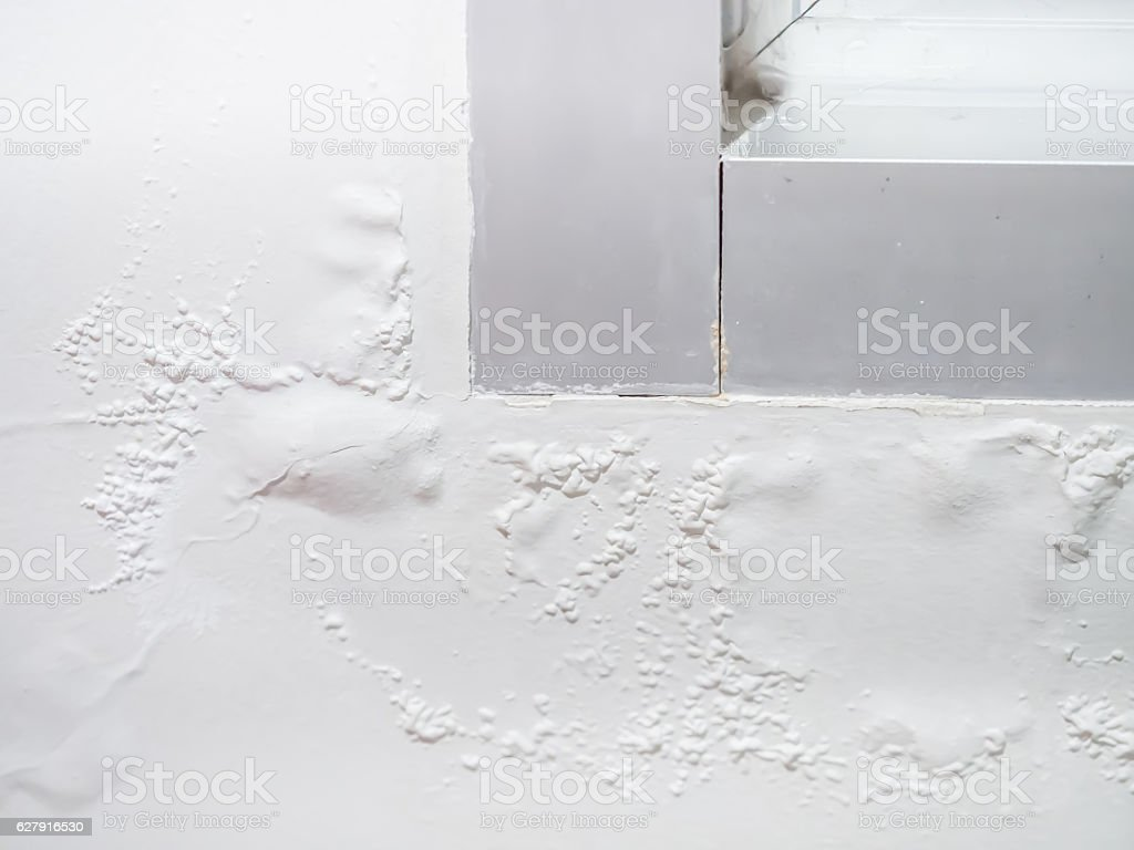 Paint blistering and peeling problems on the wall stock photo