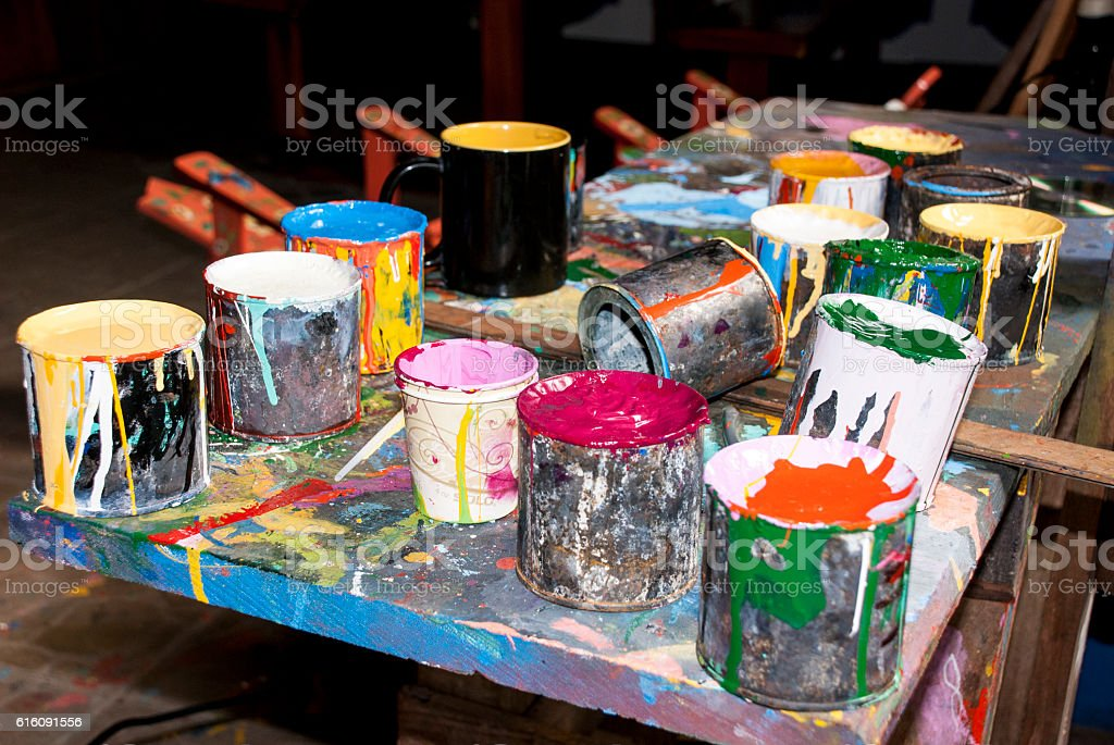 Paint bottles, brushes and paint cans stock photo