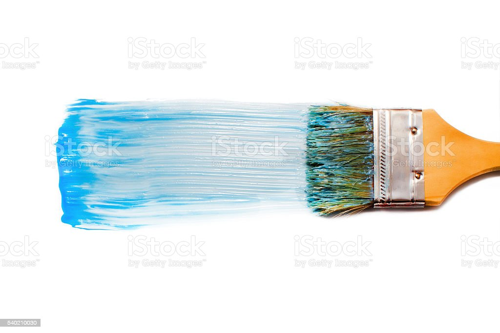 paint brush and blue dab of toothpaste stock photo