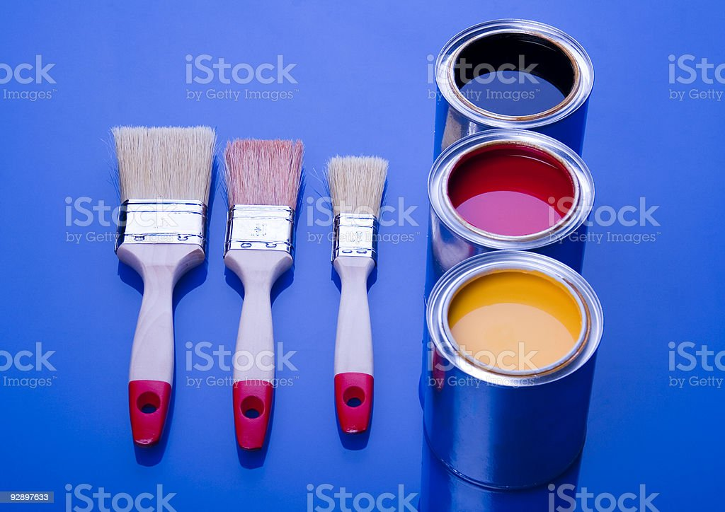 Paint brush and cans royalty-free stock photo