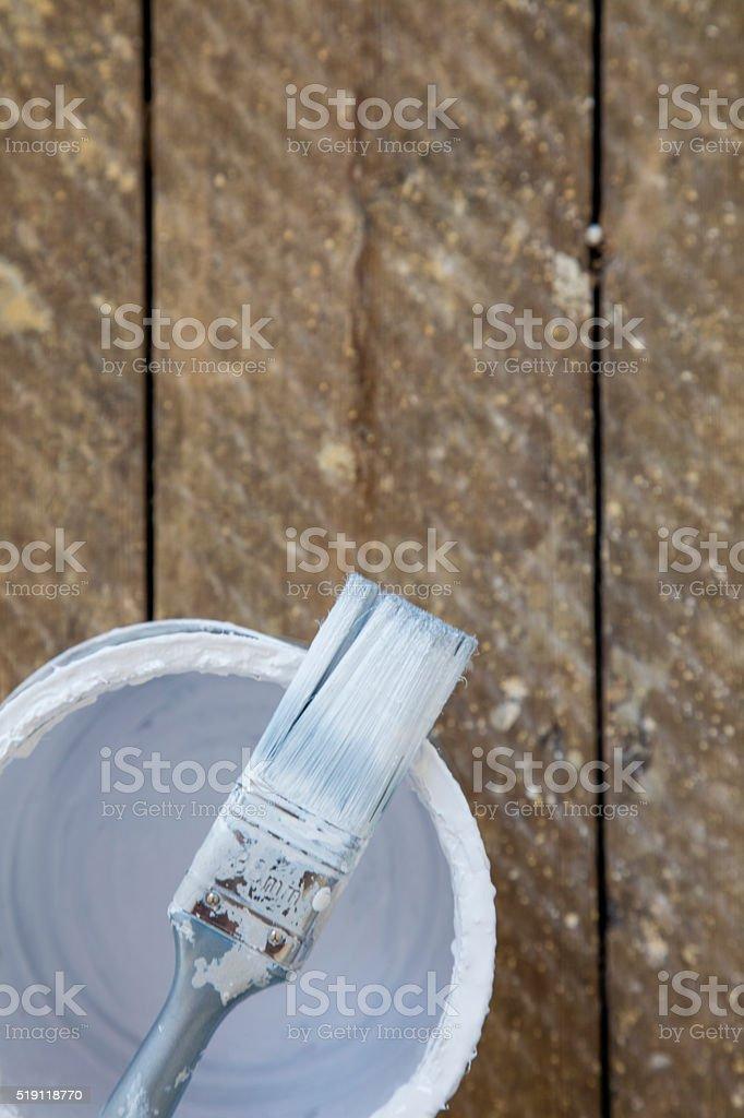 Paint brush and paint tin stock photo
