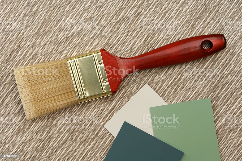 Paint brush and samples on natural texture royalty-free stock photo