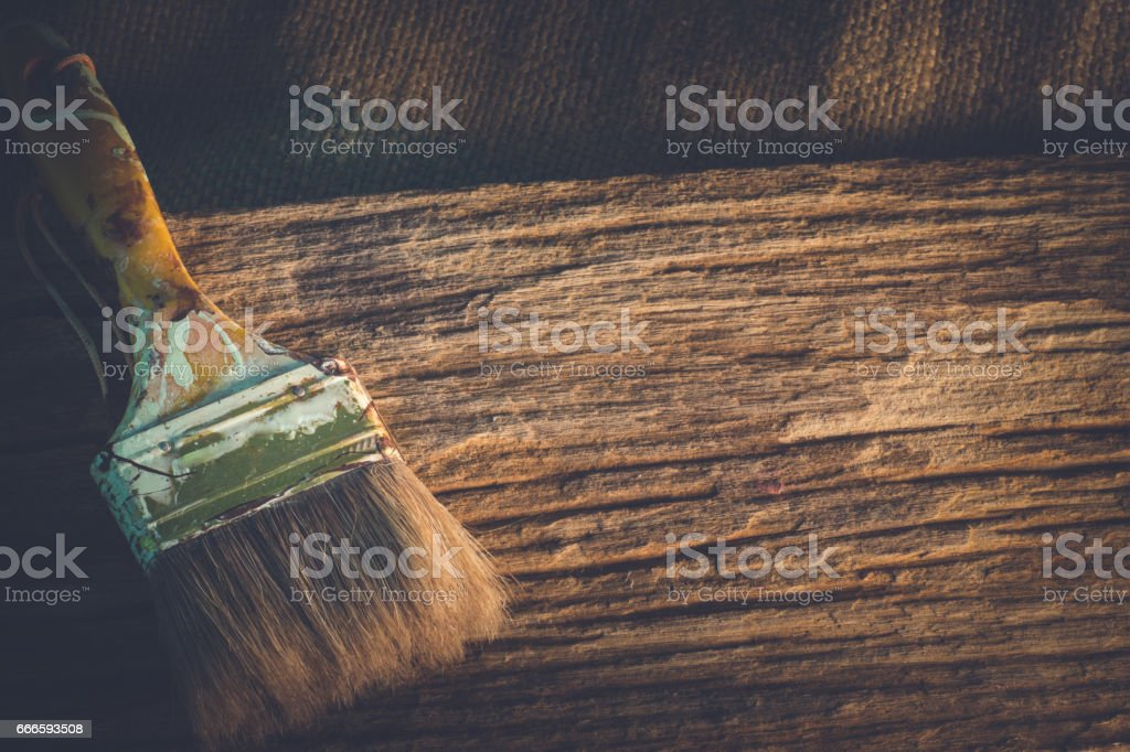 Paint brush on old wooden texture background with copy space. stock photo