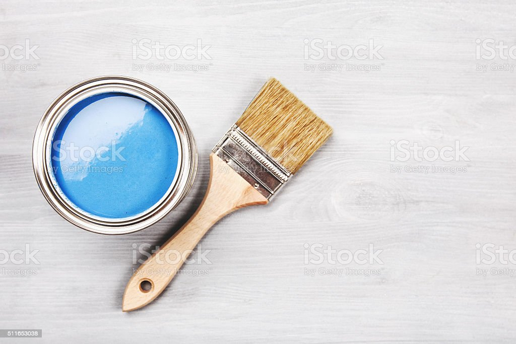 Paint brush on the can. Top view stock photo