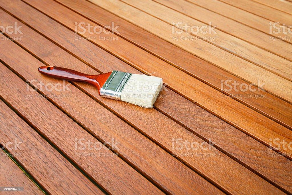 Paint brush on wooden table stock photo