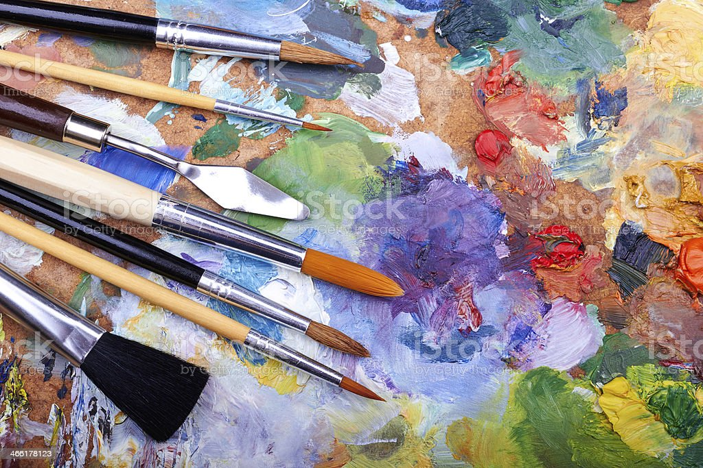 paint brushes on a palette stock photo