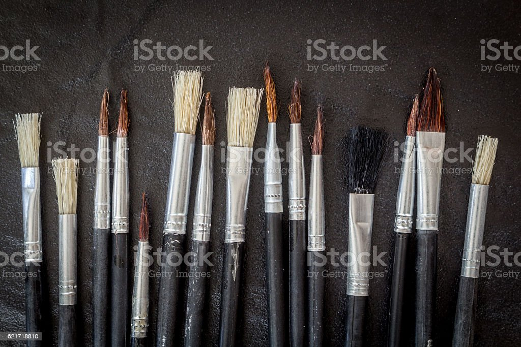 Paint brushes on black background stock photo