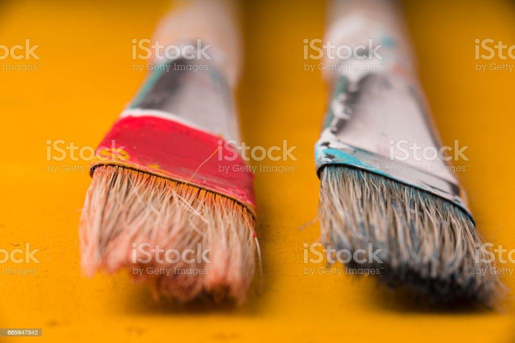 Paint brushes on the yellow background horizontal stock photo