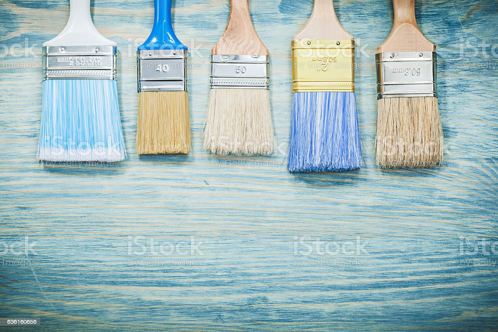 Paint brushes on wood board construction concept stock photo